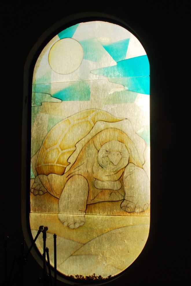 An example of the stained glass windows of the church, other images included the Blue-footed Boobie, Marine Iguana and Frigatebird