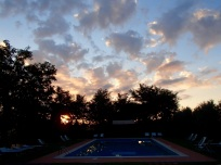 Our villa's pool at sunset