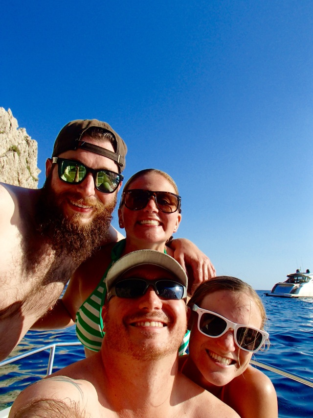 The whole crew of our boat on the turquoise waters surrounding Capri